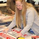 Teamsters at First Student Put Together Picket Signs for Possible Strike