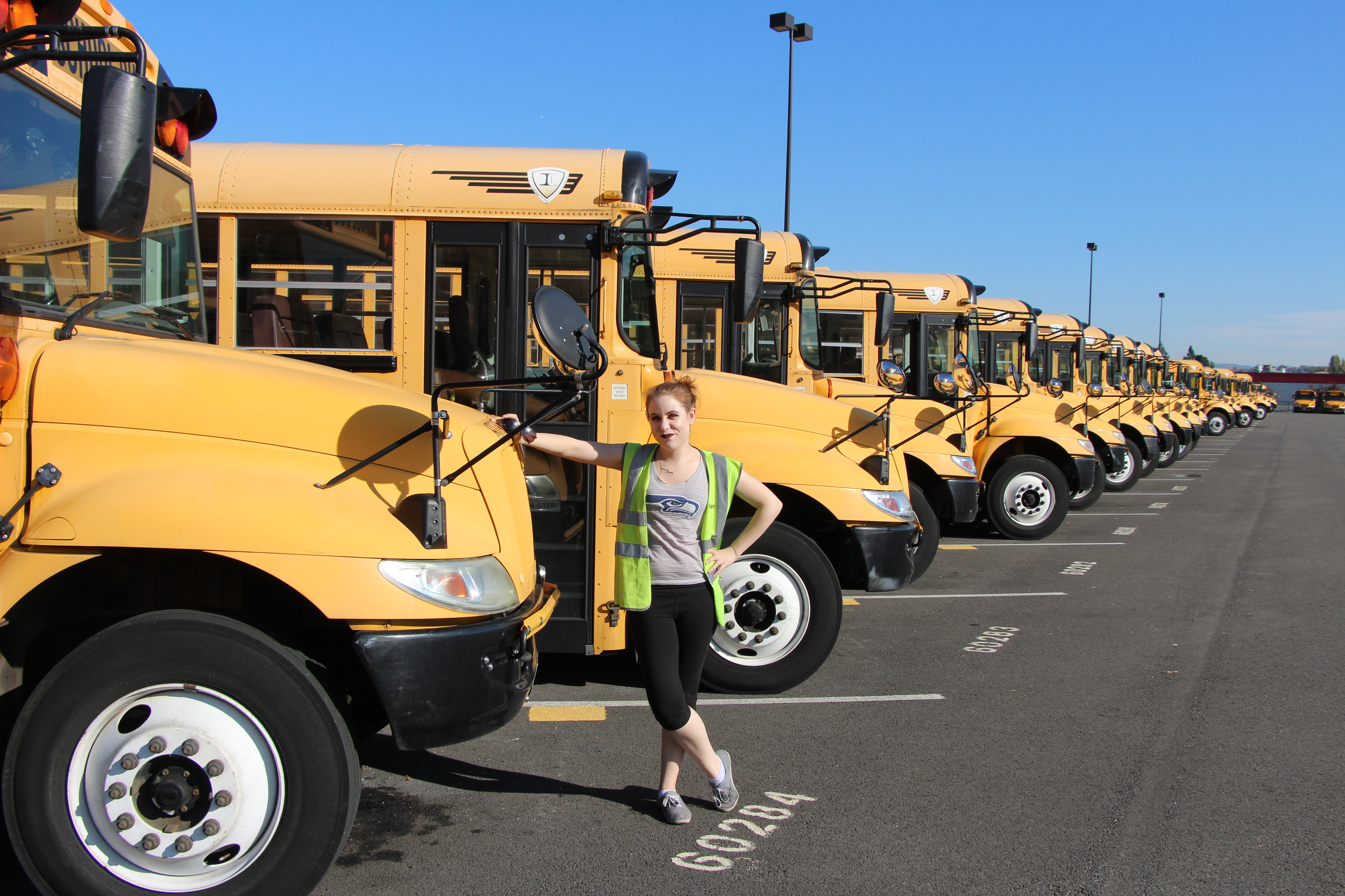 Passenger transportation olivia moore stands with her bus on the first student lot falaconquin